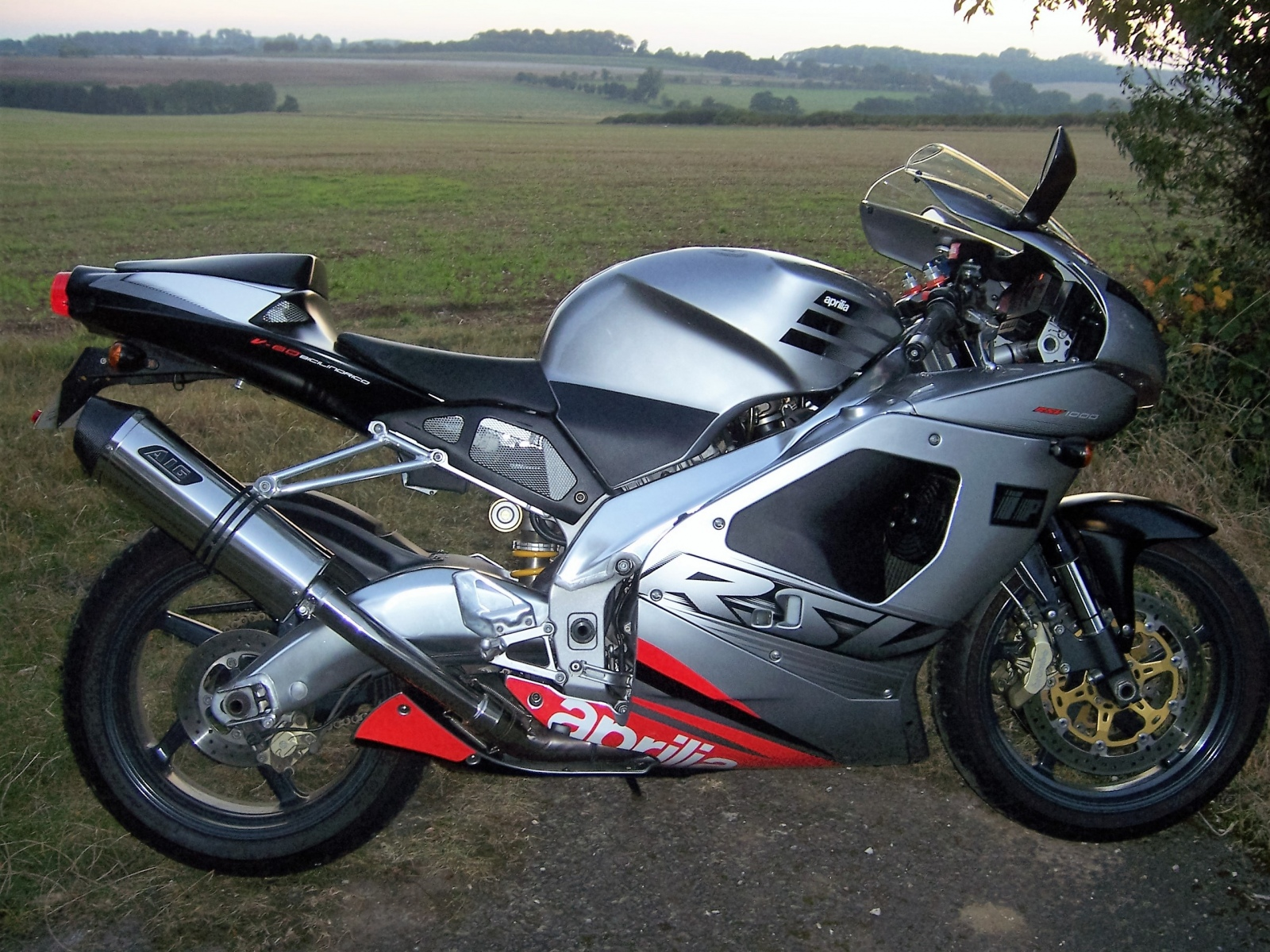 """Aprilia RSV 1000 Mille  1998-2004<p>A16 Stainless Road Legal Exhaust with Carbon Outlet</p><br /><br /><a href=""""https://a16roadnracesupplies.co.uk/product/a16-aprilia-exhausts/"""">Buy now!</a>"""