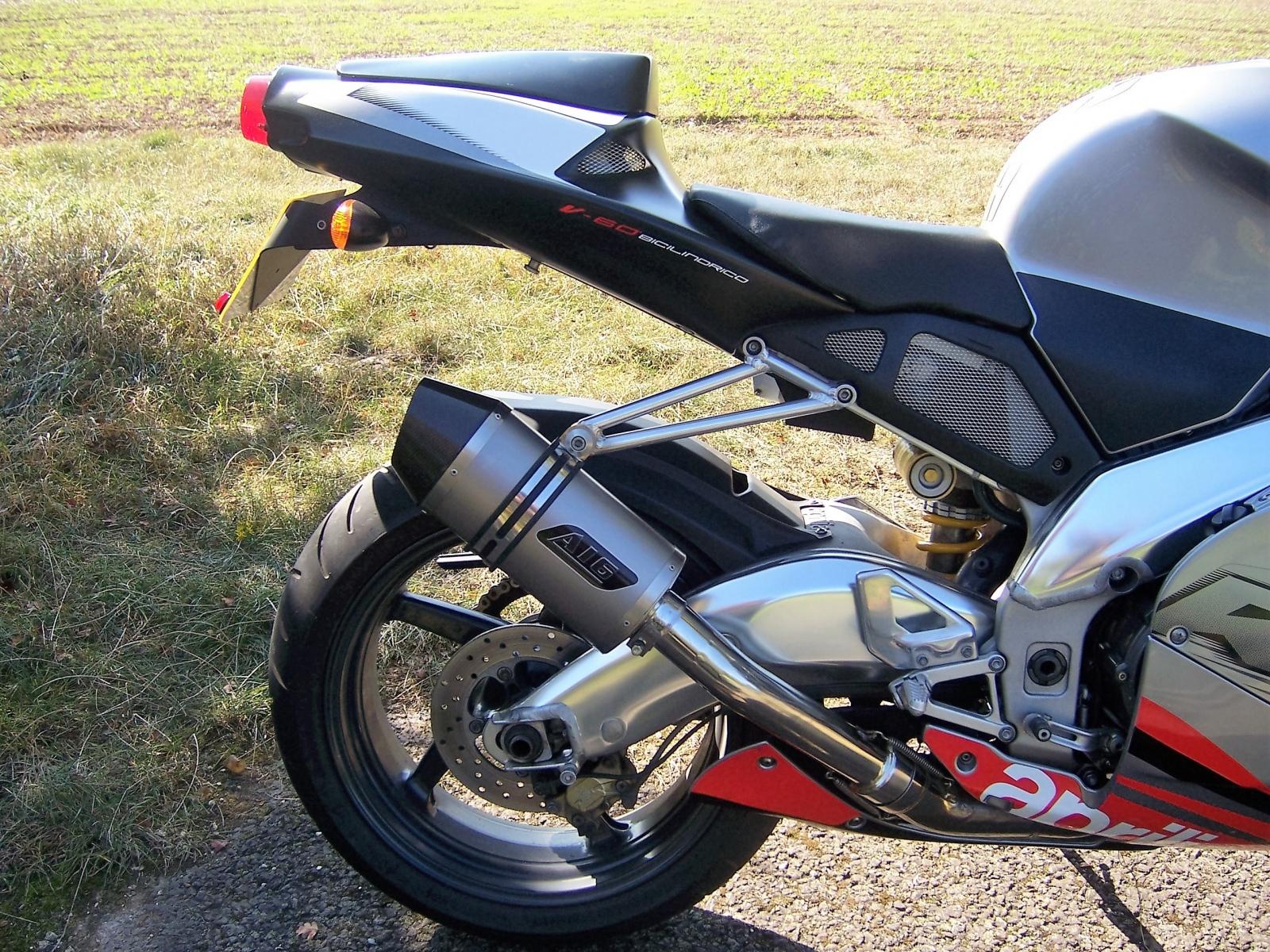 """Aprilia RSV 1000 Mille  1998-2004<p>A16 Stubby Plain Titanium Exhaust with Carbon Outlet</p><br /><br /><a href=""""https://a16roadnracesupplies.co.uk/product/a16-aprilia-exhausts/"""">Buy now!</a>"""