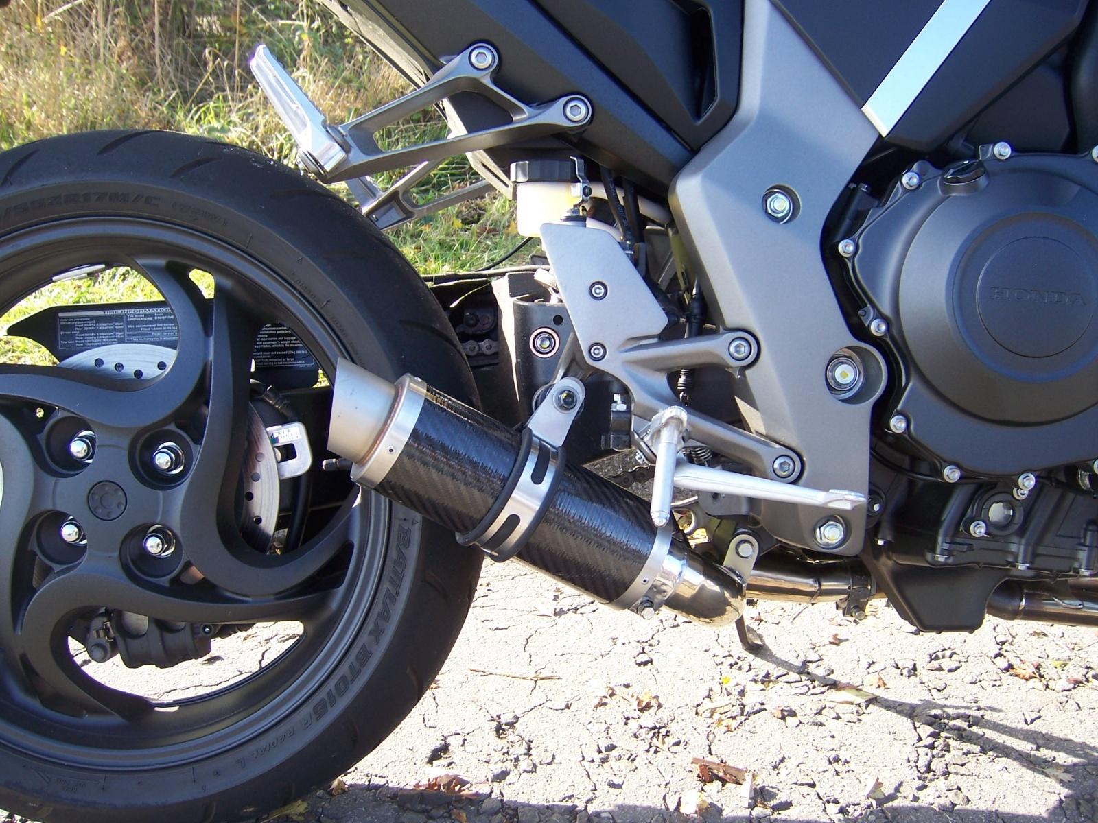 "Honda CB1000R <p>A16 Moto GP Carbon Exhaust with Titanium Type Slashcut Outlet<br/><br/><a href=""https://a16roadnracesupplies.co.uk/product/a16-honda-exhausts/"">Buy now!</a></p>"
