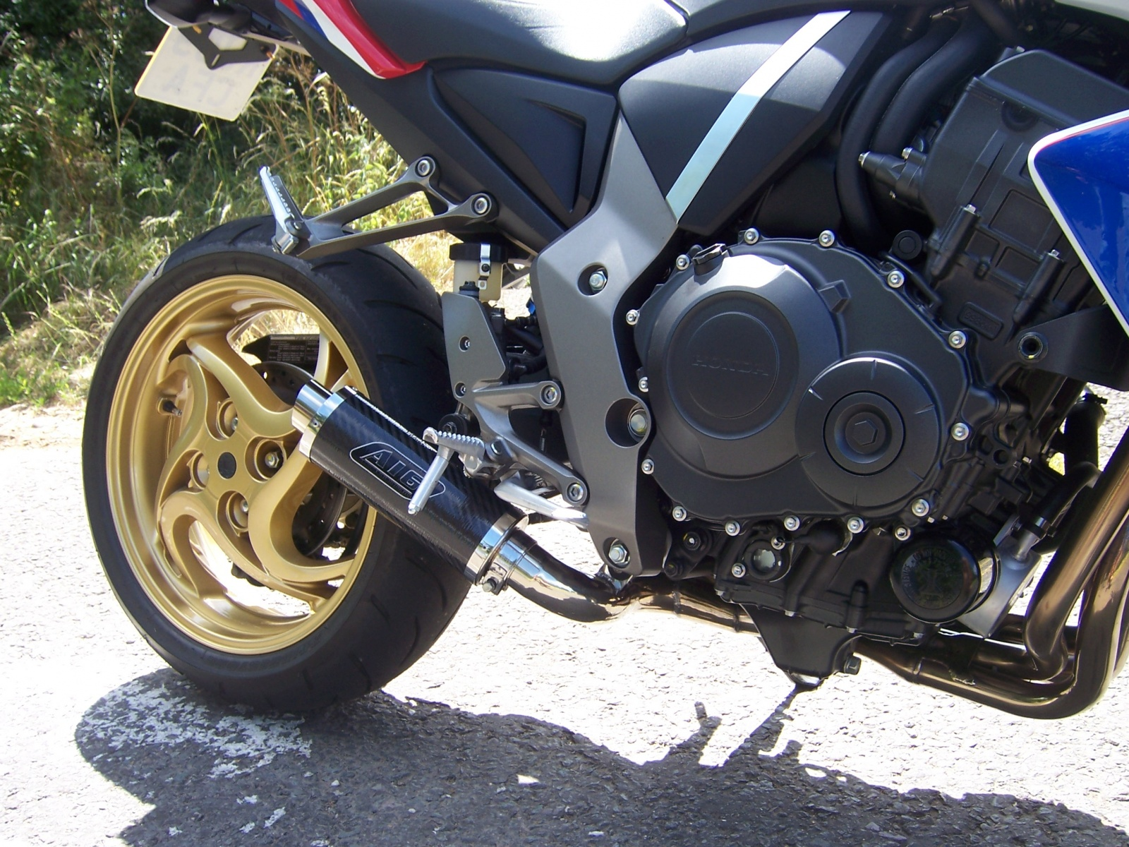 """Honda CB1000R <p>A16 Moto GP Carbon Exhaust with Polished Small Outlet<br/><br/><a href=""""https://a16roadnracesupplies.co.uk/product/a16-honda-exhausts/"""">Buy now!</a></p>"""