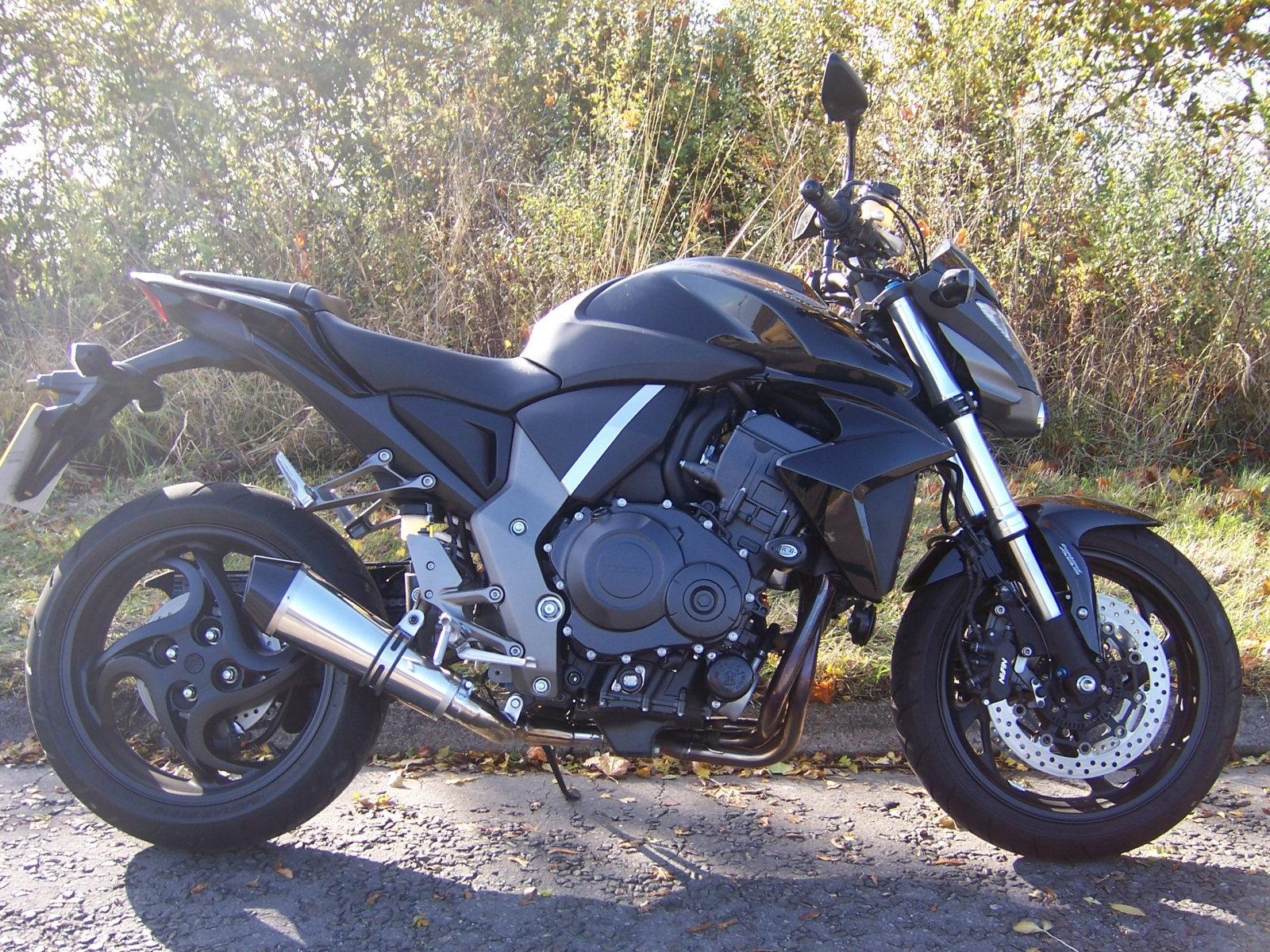 """Honda CB1000R <p>A16 Stainless Cone Exhaust with Carbon Cap Outlet<br/><br/><a href=""""https://a16roadnracesupplies.co.uk/product/a16-honda-exhausts/"""">Buy now!</a></p>"""