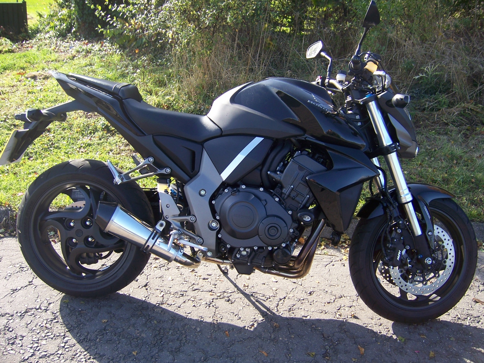 """Honda CB1000R <p>A16 Stainless Cone Exhaust with Carbon Cap Outlet</p><br/><br/><a href=""""https://a16roadnracesupplies.co.uk/product/a16-honda-exhausts/"""">Buy now!</a>"""