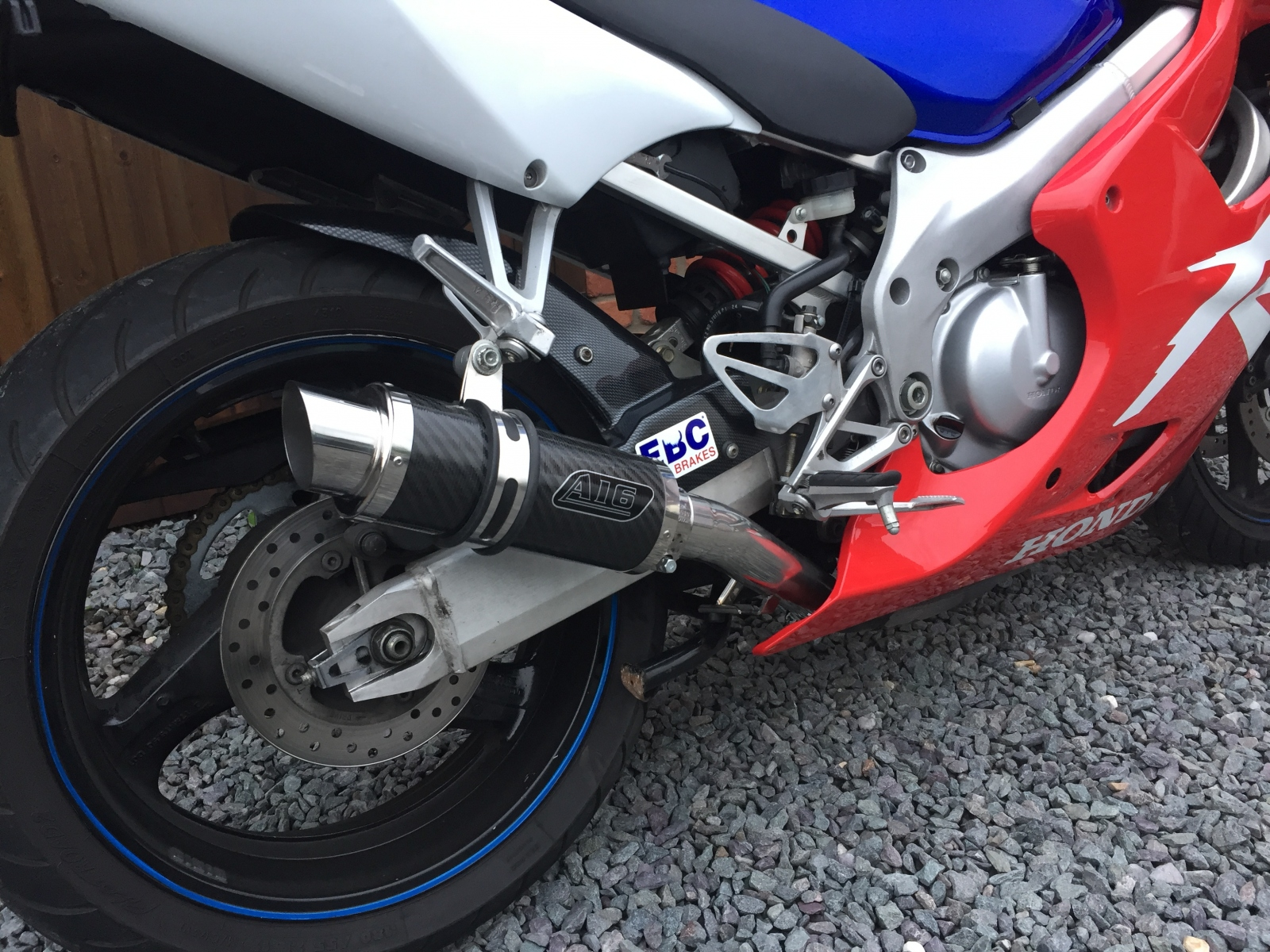 """Honda CBR600 F4 FX-FY 1999-2000<p>A16 Moto GP Carbon Exhaust with Polished Slashcut Outlet</p><br/><br/><a href=""""https://a16roadnracesupplies.co.uk/product/a16-honda-exhausts/"""">Buy now!</a>"""