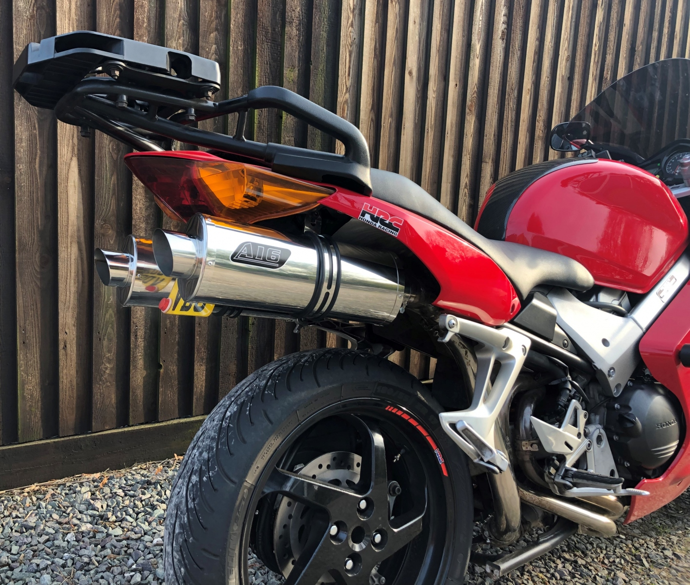 """Honda VFR800 V-Tec 2002-2008<p>A16 Road Legal Stainless Exhausts with Polished Slashcut Outlets</p><br/><br/><a href=""""https://a16roadnracesupplies.co.uk/product/a16-honda-exhausts/"""">Buy now!</a>"""