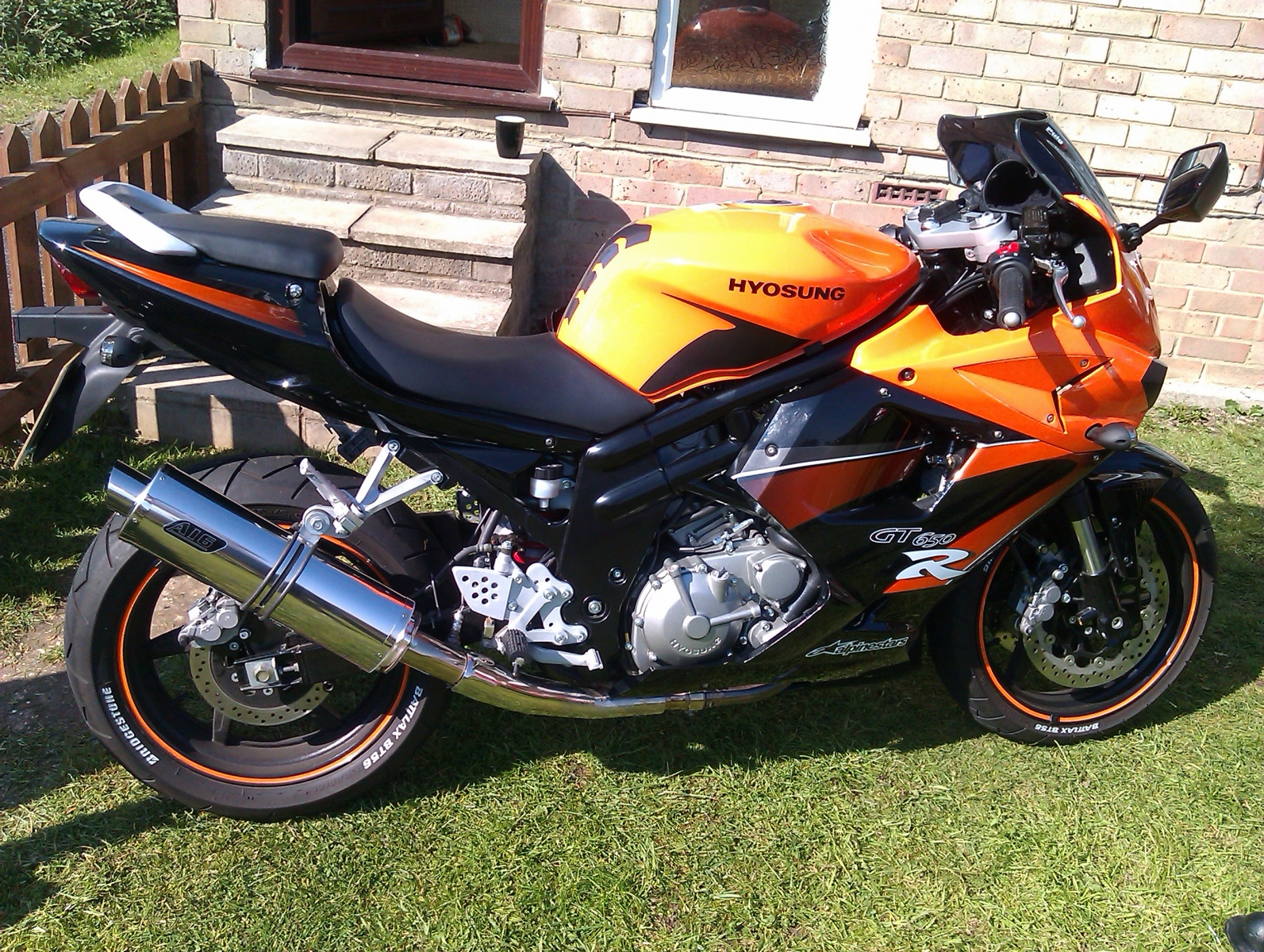 """Hyosung GT650<p>A16 Road Legal Stainless Exhaust with Slashcut Outlet</p><br><a href=""""https://a16roadnracesupplies.co.uk/product/a16-hyosung-exhausts/"""">Buy now!</a>"""