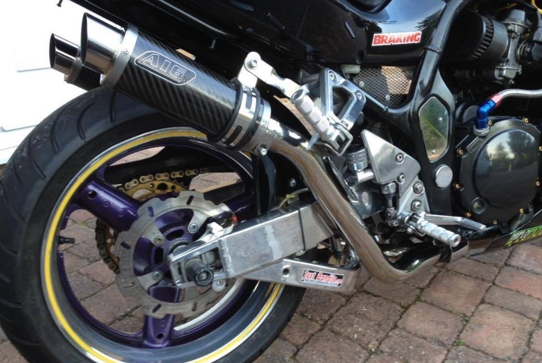 """Suzuki GSF 1200 Bandit<p>A16 Twin High Level Exhausts</p><p>A16 Moto GP Carbon Exhausts with Polished Slashcut Outlets</p><br /><a href=""""https://a16roadnracesupplies.co.uk/product/a16-suzuki-exhausts/"""">Buy now!</a>"""