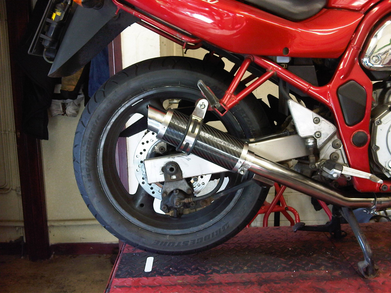 """Suzuki GSF 600 Bandit<p>A16 Moto GP Exhaust with Titanium Type Outlet</p><br/><a href=""""https://a16roadnracesupplies.co.uk/product/a16-suzuki-exhausts/"""">Buy now!</a>"""