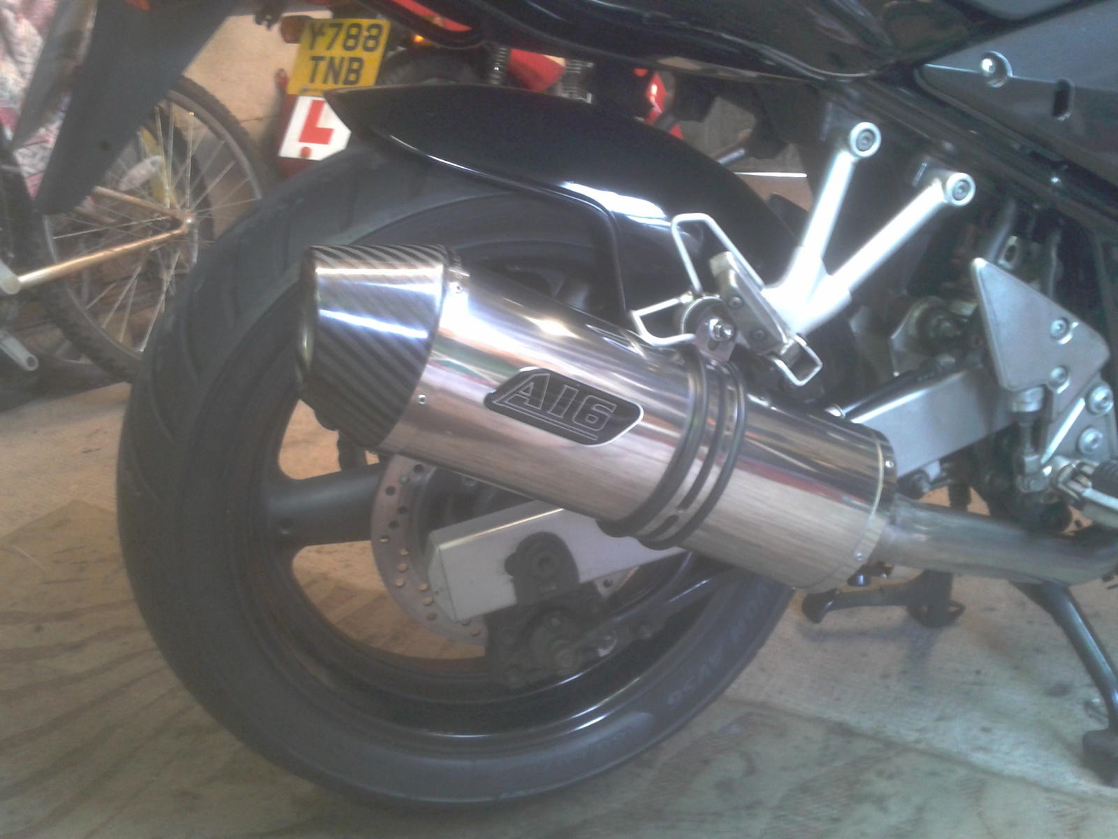 """Suzuki GSF 600 Bandit<p>A16 Road Legal Stainless Exhaust with Carbon Cap Outlet</p><br/><a href=""""https://a16roadnracesupplies.co.uk/product/a16-suzuki-exhausts/"""">Buy now!</a>"""