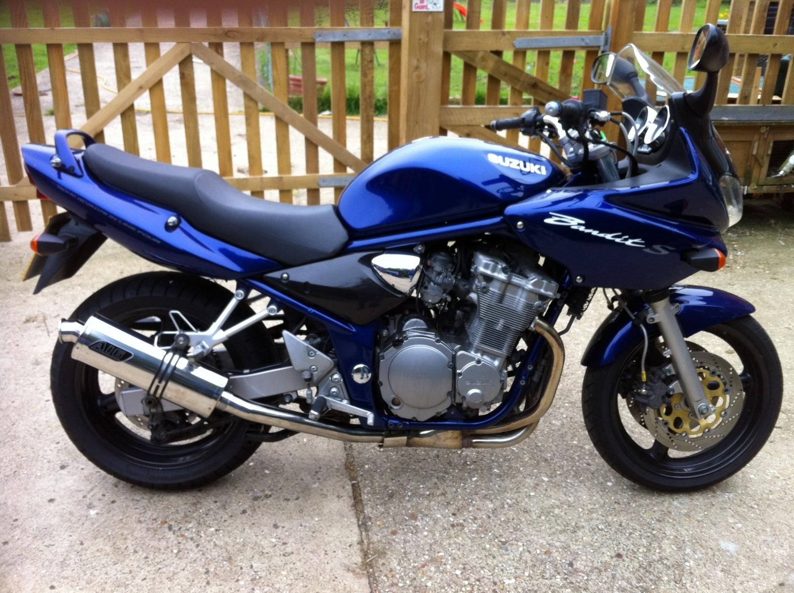 """Suzuki GSF 600 Bandit<p>A16 Road Legal Stainless Exhaust with Traditional Spout</p><br/><a href=""""https://a16roadnracesupplies.co.uk/product/a16-suzuki-exhausts/"""">Buy now!</a>"""