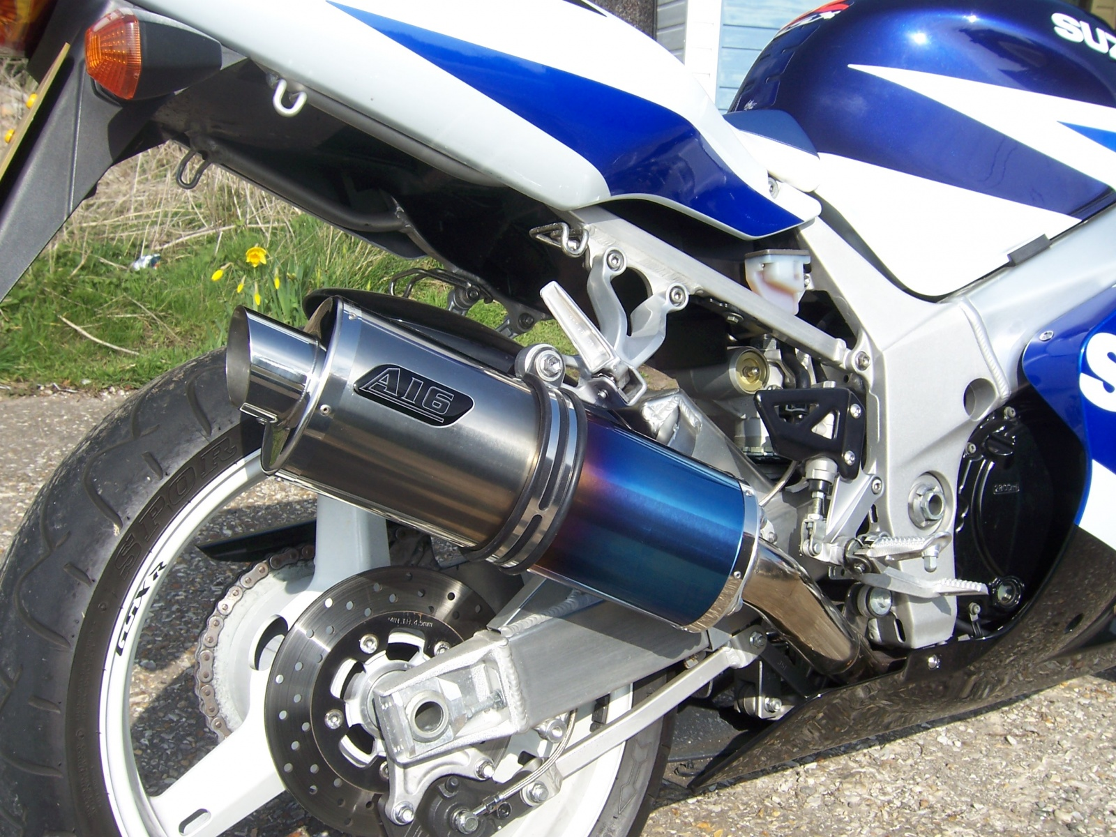 """Suzuki GSXR 600 750 K1-K5 2001-2005<p>A16 Road Legal Coloured Titanium Exhaust with Slashcut Outlet</p><br><a href=""""https://a16roadnracesupplies.co.uk/product/a16-suzuki-exhausts/"""">Buy now!</a>"""